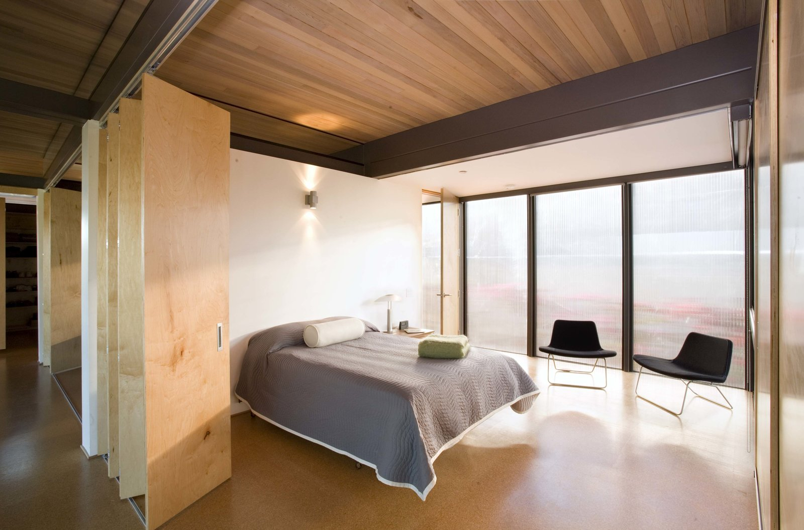 Bedroom, Linoleum Floor, Bed, Wall Lighting, Chair, Night Stands, Lamps, and Table Lighting  Photo 17 of 21 in Here Are the Modern Prefab Designs That Amazon's Investing In