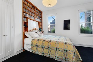 Built-in shelving in another bedroom holds more than enough bedtime reading.