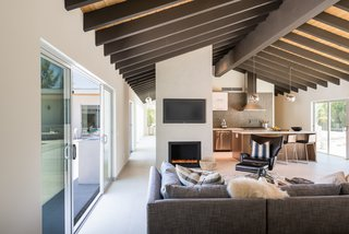 Sliding doors lead to the central courtyard, providing easy indoor/outdoor living and effortless entertaining.