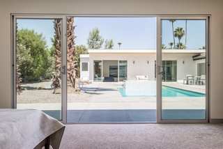 There are also sliding doors leading out to the pool.