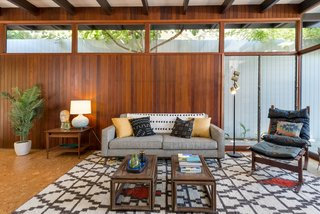 Wood paneling and clerestory windows add to the authentic midcentury charm.