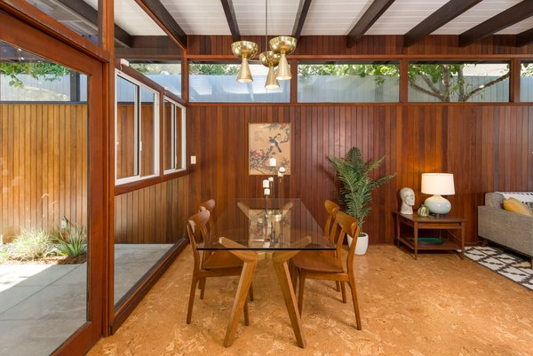 A look at the dining area. Note how the wood paneling appears to extend straight out into the fence on the exterior.