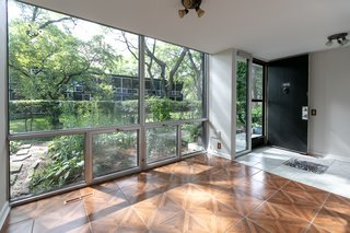Floor-to-ceiling windows allow for plenty of natural light to enter the home.
