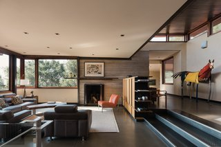 The open-plan interiors are flooded with natural light, which streams through a wall of east-facing windows to the clerestory that step up and down with the design.