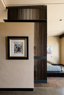 There are five bedrooms, including a main-level master suite.