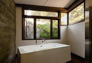 A light-filled bath with a deep soaking tub.