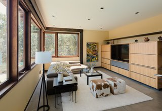 The lower level features a bonus family room with a wall of built-in media cabinetry.