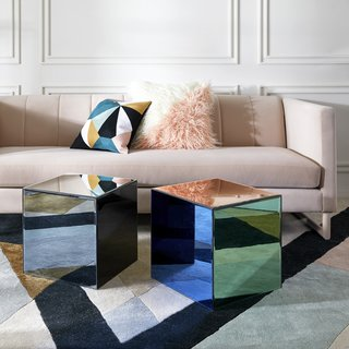 The Vally Sofa in Blush velvet is winner, especially when paired with a few fun throw pillows and mini mirrored Chroma Cube Accent Tables.