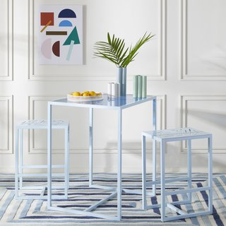 The three-piece metal and glass Valley Bistro set is perfect for a small kitchen or nook.