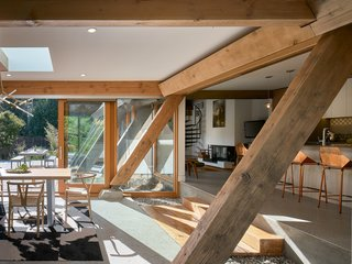 Bright and airy, thanks to extensive glazing, the new space embraces the home's original timber framing.
