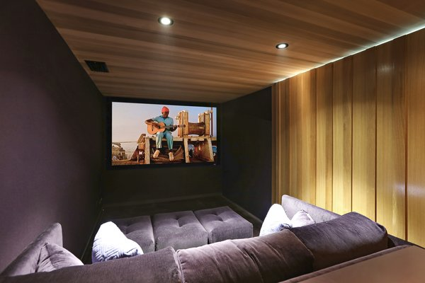 A spacious screening room is one of the home's new features.