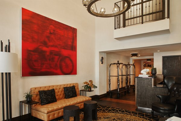 The lobby features a bold crimson portrait of Hotel Figueroa's original managing director, Maude Bouldin. It was produced by local Los Angeles artist Alison Van Pelt.