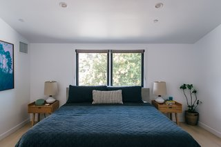 The Wyatt bed is from Room & Board, and the Mimico nightstands are from Gus Modern.