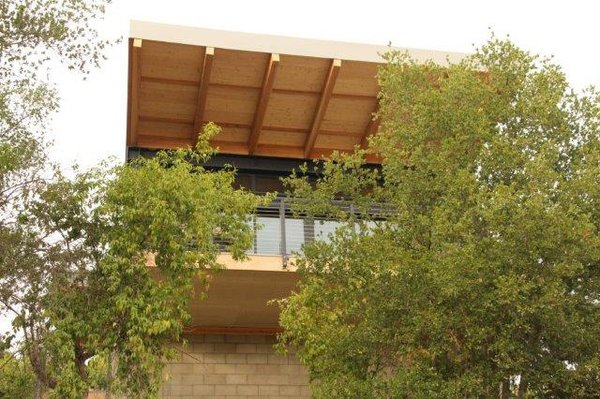 Fire-rated exposed timber soffits and steel decks are additional non-combustible elements.