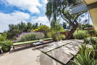 The home is surrounded by gorgeous greenery and peaceful views.