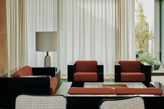 The elegant apartment is furnished with vintage pieces sourced by Speake's company Retrouvius.