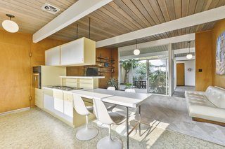 The kitchen cabinetry is also original and contributes to the authentic midcentury vibe.