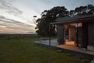The orientation of the home captures the sunrise and moonrise over the water.