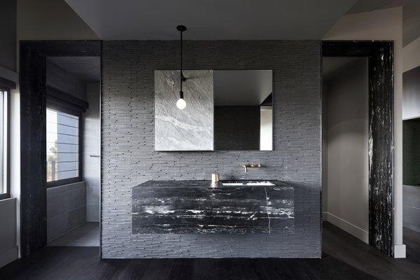 The minimalist bathroom provides a calm, introspective experience.