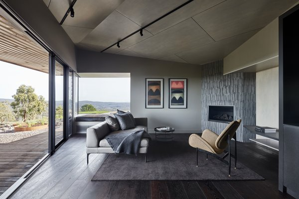 The open-plan living space provides a front-row seat to the spectacular scenery, which is framed by floor-to-ceiling sliding doors that further integrate the outdoors.
