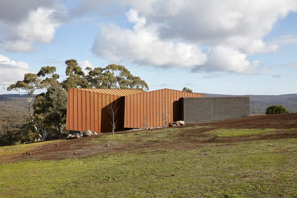 Cor-Ten steel was selected both for its aesthetic appeal and its ability to integrate into the landscape, evolving over time and with the seasons. It also met the client's request for a building that didn't require ongoing external maintenance.