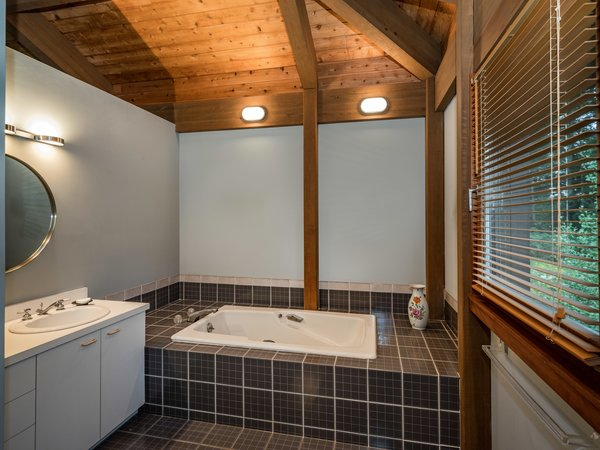 The master bath has two sections—one with a toilet and shower stall, and one with a soaking tub.