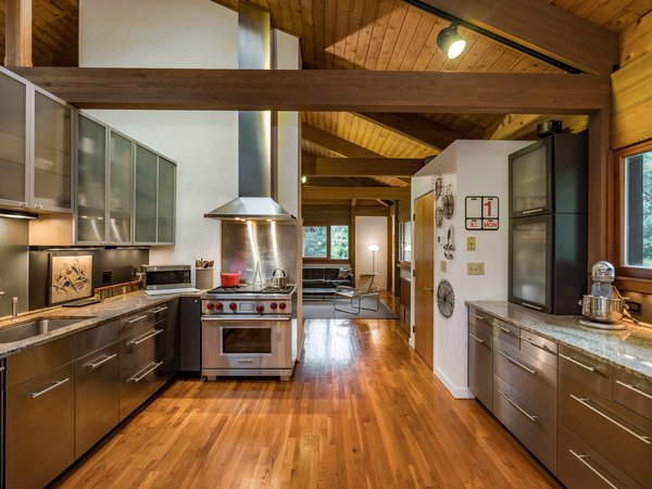 The stainless steel kitchen has been updated with modern top-of-the-line appliances.