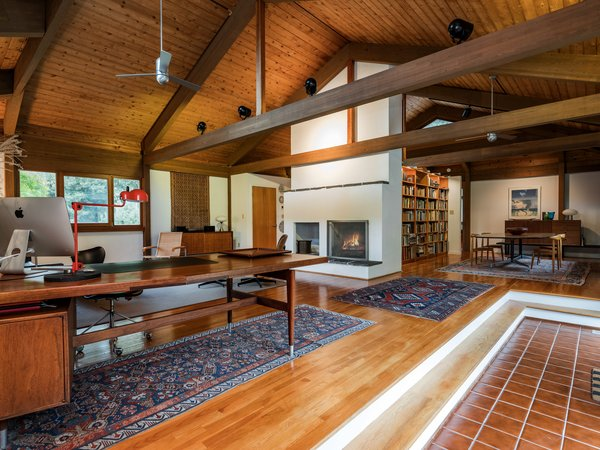 The cedar-paneled cathedral ceilings give the interiors an airy sense of space.