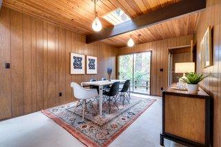 The warm wood paneling is original.
