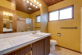 The home's two bathrooms are spacious but in needof updates.