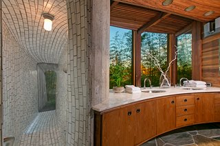 Artist, James Hubbell, who also worked on Kellogg's Onion House in Maui, is said to have designed the very unique master shower.
