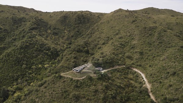 An aerial view of Casa FM  Photo 11 of 13 in A Concrete Hillside Home With a Green Roof and Killer Views