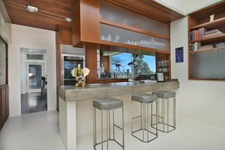 The wood-and-stone bar at the edge of the living room makes for easy entertaining.