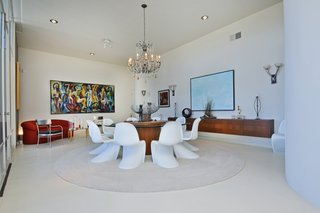 The spacious, formal dining room features a floating credenza.