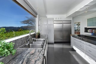 The updated, modern kitchen has plenty of counter space.