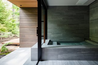 The outline of the bath appears to extend to the exterior of the home.