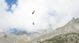 One section of the alpine shelter being airlifted.