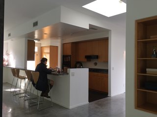 Myers breathed new life into the dated kitchen by totally opening up the space.