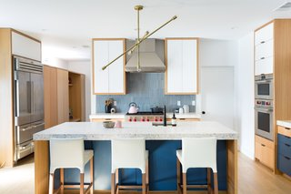 The beautiful blue backsplash tiles are from Heath Ceramics. The tiles' vertical orientation is a little twist that suits the vertical space.