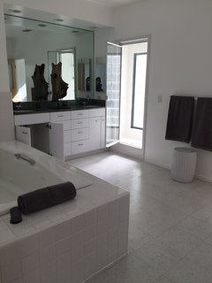 Myers' first move in the master bath was to flip-flop the placement of the bathtub and the vanity.