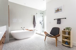 """The bathroom floor is made of 24"""" square terrazzo tiles from Concrete Collaborative. The walls and shower floor feature Heath Ceramics field tiles."""