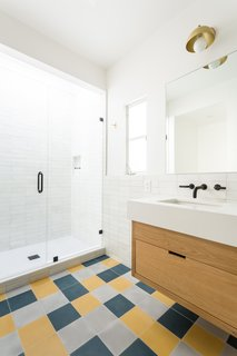 The sink, shower, and tub faucets are from California Faucets.