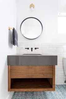 The sink, shower, and tub fixtures are from California Faucets.