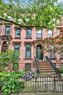 The classic four-story townhouse is located on a block in the recently expanded Park Slope Historic District.