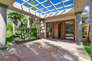 The entrance to the home features hand-carved Moroccan wooden doors.