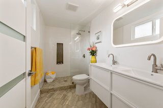 The master bath has a tiled shower and a double vanity.