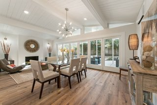 The living/dining room boasts designer lighting and a wood-burning fireplace.