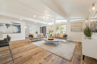 The interior is bright and airy with a white tongue and groove ceiling.