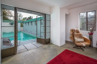A sitting room is located just off the pool.
