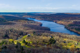 The luxurious country estate has breathtaking panoramic views of the Croton Reservoir and beyond.